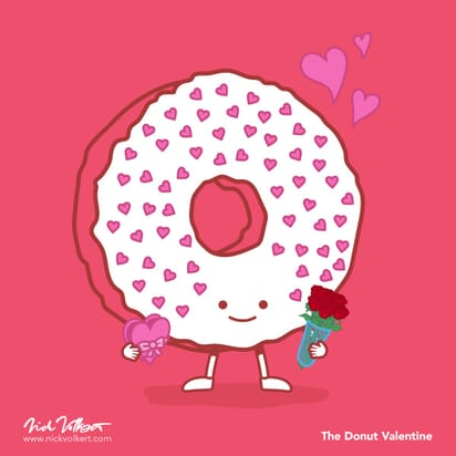 An iced donut holding flowers and covered in hearts.
