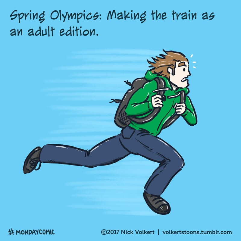 A man is in a full sprint to catch his train.