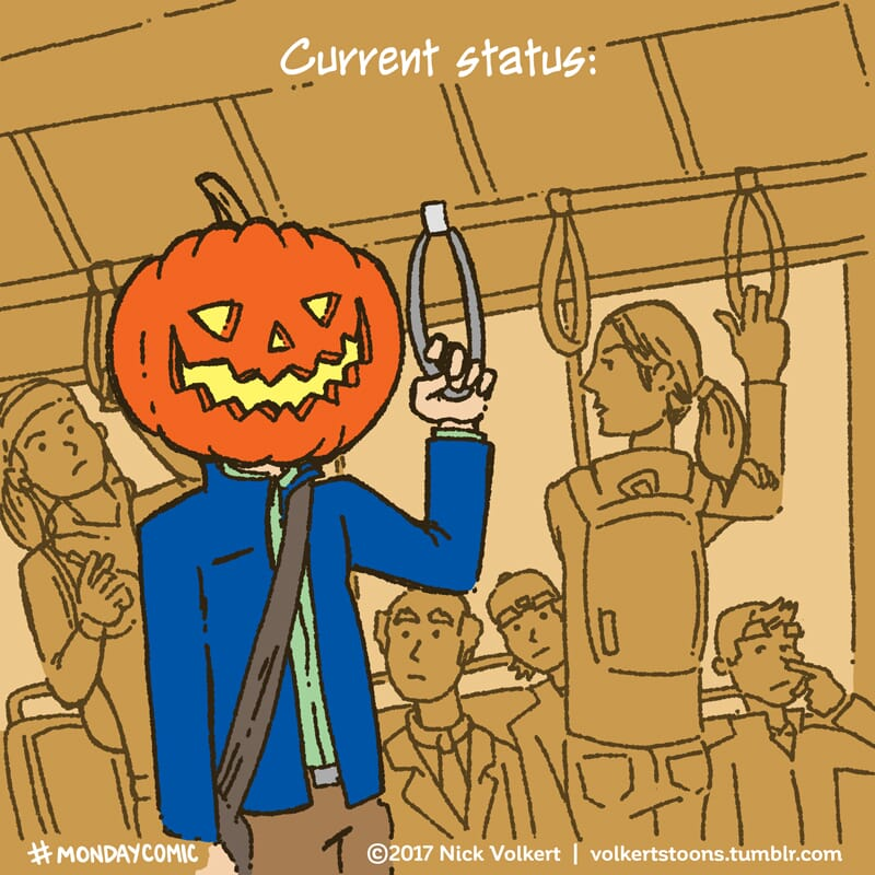 A man with a jack o'lantern for a head on his morning commute.