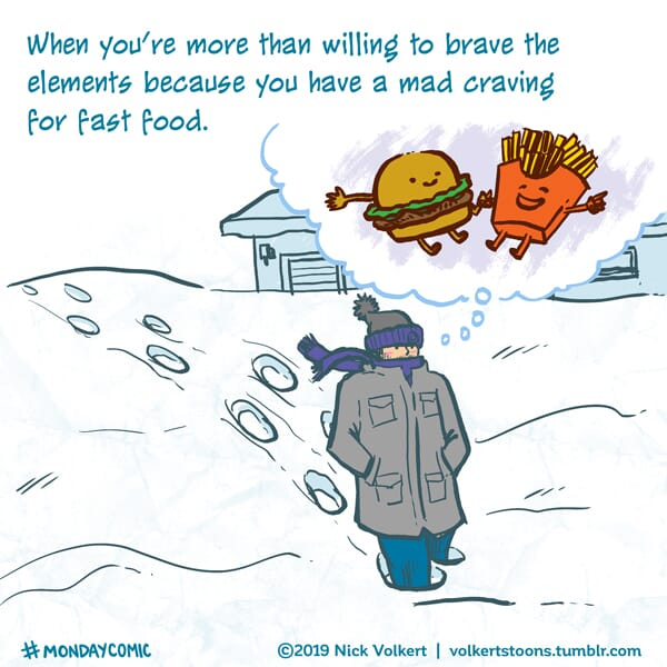 A man braves the elements for fast food.