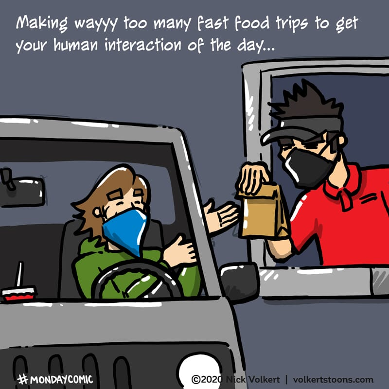 A man in a mask happily gets food and human interaction in a fast food drive thru.
