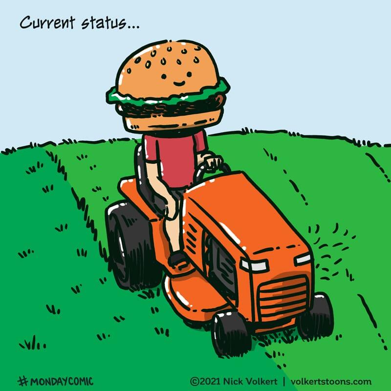 A man with a burger head mows his lawn.