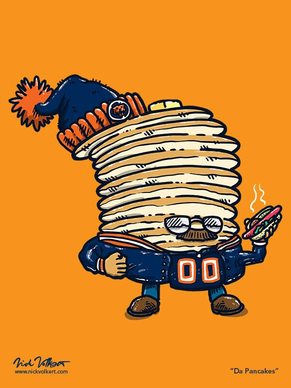 Captain Pancake is dressed like a Chicago Bears Superfan, and is holding a chicago-style hot dog