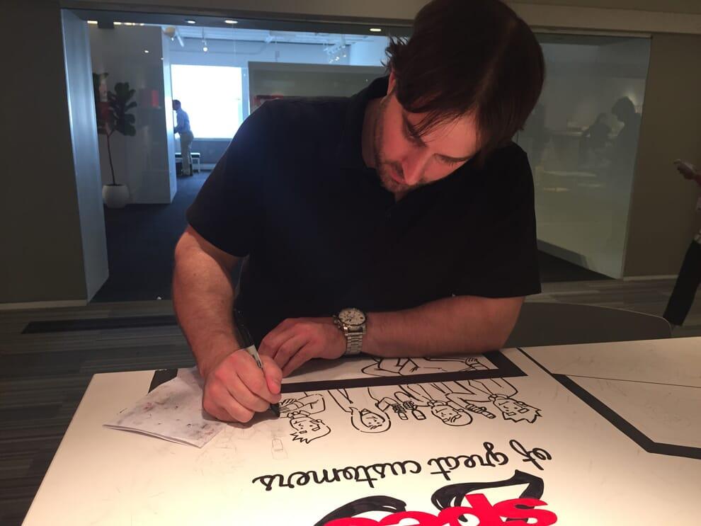 Nick Volkert working on mural for Spec Furniture in the Merchandise Mart