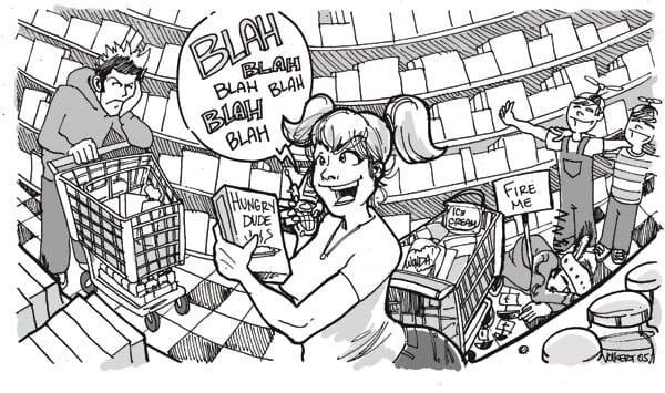 A woman gabbing on the phone blocks an entire shopping aisle.